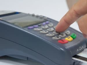 person using a credit card reader