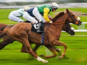 jockey racing on horse
